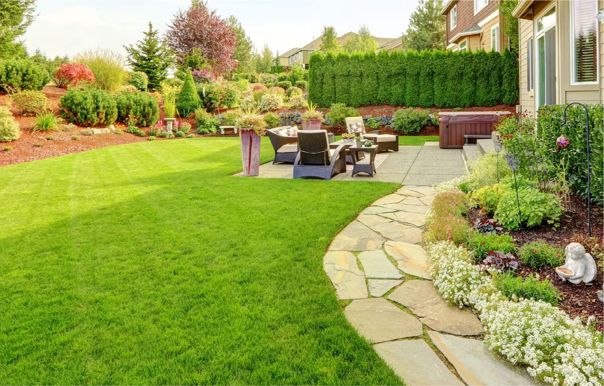 back yard with amazing landscaping, small garden, and seating area